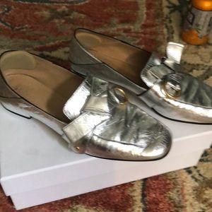 Silver Chloe loafers.
